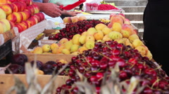 Woman chooses fruits on spontaneous market in Batumi. Stock Footage