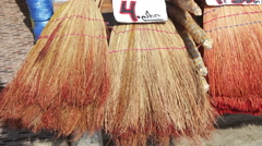 Brooms are Sold on the Market Stock Footage