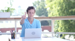 No, Denying Offer Gesture by Young Man at Work, Outdoor Stock Footage
