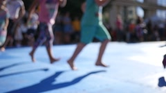 Kids legs running in slow motion at street festival sport workout Stock Footage