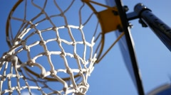 Basketball hoop on the playing field agains a blue sky background Stock Footage