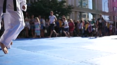 Kids running in slow motion at street festival sport workout for active children Stock Footage