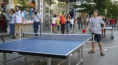 Family playing table tennis on street cultural sport urban festival in Sofia  Stock Footage
