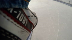 ACTION CAM: Human legs in a skates on a ice Stock Footage