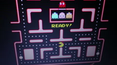 Ms. Pac Man - Medium player perspective with 'Ready!', then game play Stock Footage