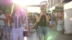 Teenager girl walk crowded street watch type slide smart phone chatting online Stock Footage