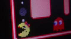 Macro view Ms. Pac Man Game Play - Red monster chases Stock Footage
