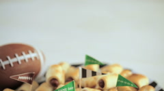 Mini Pigs In A Blanket for football game party. Stock Footage