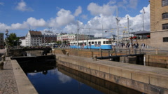 Over the canal lock to Central Station, Gothenburg  Trams pass Stock Footage