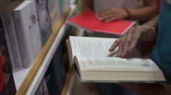 Man choose a book in a store Stock Footage