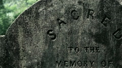 Panning video of ancient memory tombstone with sacred to the memory words Stock Footage