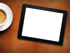 Tablet white screen similar to ipad display and coffee Kuvituskuvat