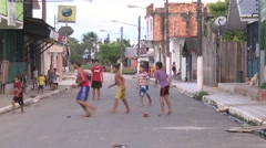 Barefoot children play soccer in an Amazonian village Stock Footage