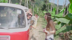 Hippie Girl and the Minivan Driver Having Fun with Ukulele Music. Slow Motion Stock Footage