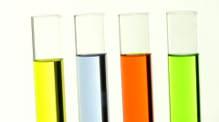 Test tubes with colored liquids abuzz Stock Footage