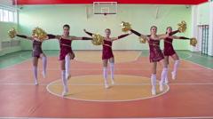 Cheerleaders Performing in School Gym Stock Footage