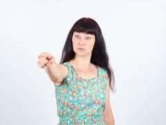 Young woman accusing someone  pointing with finger Stock Photos