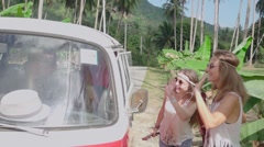 Hippie Girl Greet Minivan Driver Sitting in the Driver's Cab. Slow Motion Stock Footage