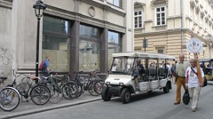 Tourist Electric Sightseeing Car carries tourists to the city center - Krakow Stock Footage