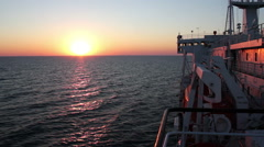 Sunset on the Sea with Moving Cargo Ferry Stock Footage