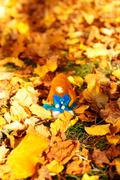 Beautiful felting elf in the autumn leaves Stock Photos