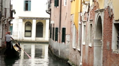 Venice Italy small canals and bridges gondola boat  Stock Footage