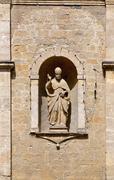 Statue on the Church of San Pietro in Volterra Stock Photos