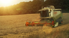 Combine Harvester working on Wheat Field Stock Footage