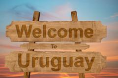 Welcome to Ecuador   sing on wood background with blending national flag Stock Photos
