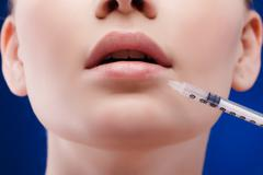 Beauty woman botox injections. Treatment with hyaluronic collagen HA injection Stock Photos