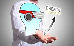 Creative technology concept above a human hand Stock Photos