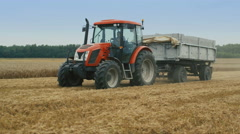 Agricultural Tractor Towing Trailer. Stock Footage