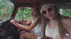 Hippie Girls Have Fun Playing Hawaiian Guitar in a Cabin of Minivan. Slow Motion Stock Footage
