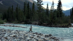 Mountain Creek Convergence and Cairn in Evening Pullback Stock Footage