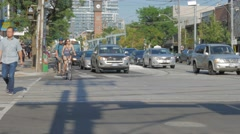 Cyclists Bike Riding Through College Bathurst Intersection 2 Stock Footage