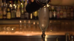 Cocktail in a champagne glass Stock Footage