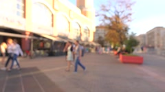 Blurred street view. Cafe and shopping center. 4K background bokeh video Stock Footage