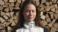 Portrait of a woman in front of the woodpile Stock Footage