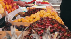 Showcase Fruits. Woman chooses fruits on spontaneous market in Batumi. Stock Footage