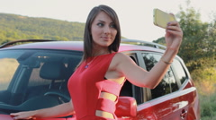 Attractive young woman taking selfie on the phone near her car Stock Footage