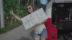 Hippie Girls Catch Passing Car near the Broken Minivan. Slow Motion Stock Footage