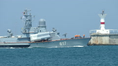 Russian missile boat enters the military base Stock Footage
