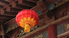Traditional red Chinese lantern hangs in Xian, China. Stock Footage