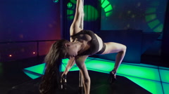 Fitness pole dancing graceful girl performing poledance tricks in slow motion Stock Footage