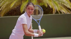 Athlete with ball and racket beside green wall Stock Footage