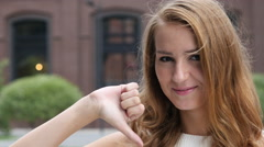 Thumb Down by Beautiful young Girl, Outdoor Stock Footage