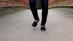Close up of dancing woman's legs  on the bridge Stock Footage