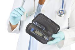Doctor Holding Diabetic Supplies Stock Photos