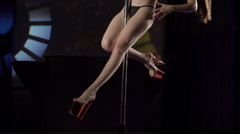 Attractive pole dancer performing hot dance on lighted stage at nightclub Stock Footage