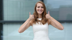 Thumbs Up by Girl Outside Office Stock Footage